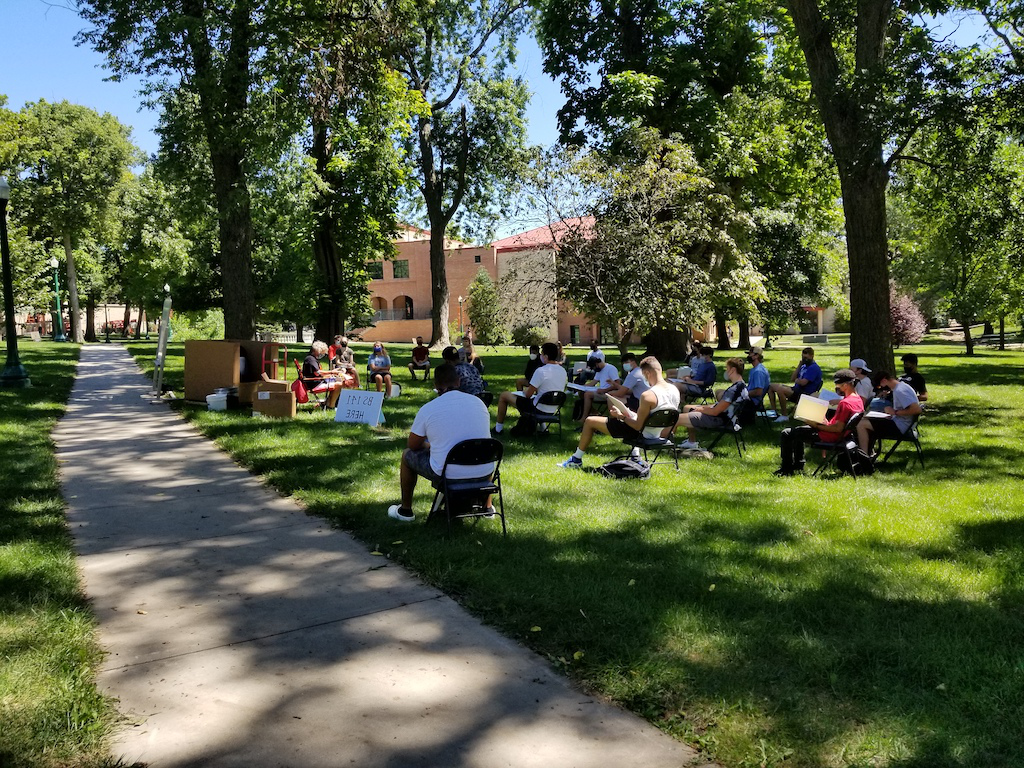 Picture of introduction to business class, BS 141, enjoying class outside on the first day